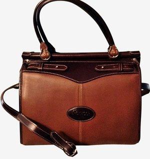 d798bfb03923 Argentinian leather saddle shaped handbag purse