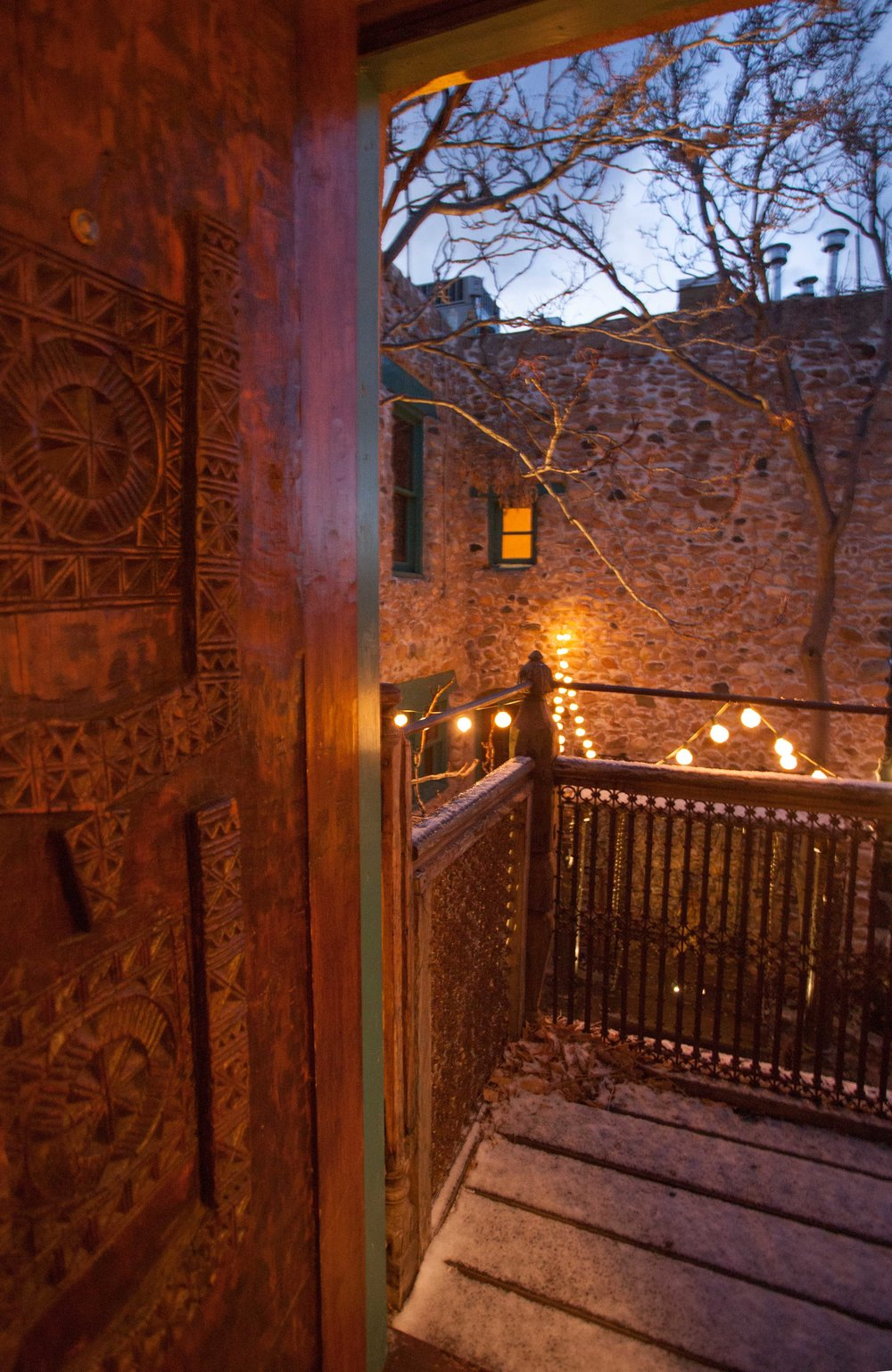 Balcony view overlooking the stone house courtyard.