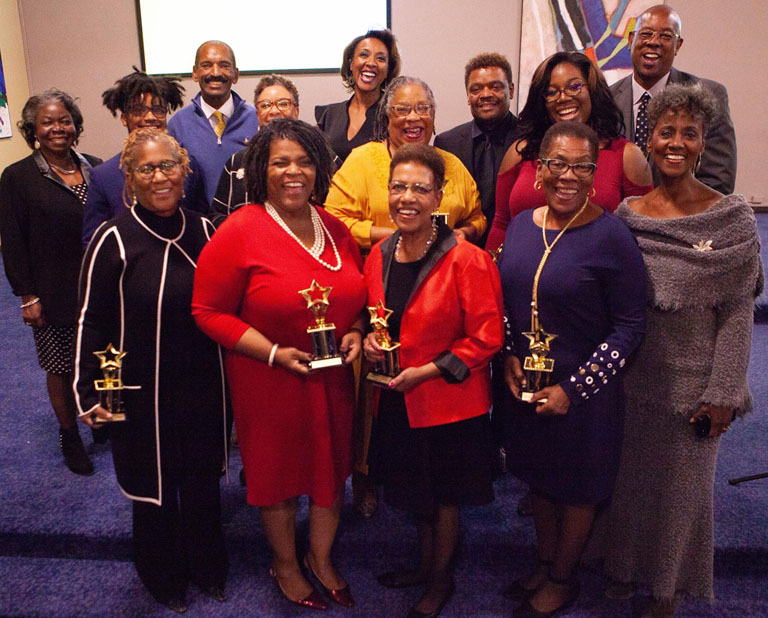 2018 Living Legends  Wiley Price  (back row in blue sweater) and  Art Holliday  (back row, far right) with event committee members and keynote speaker   Dorothy Tucker  , VP-Broadcast of the  National Association of Black Journalists  (front row, far right). Photo by  Rosalind Guy .