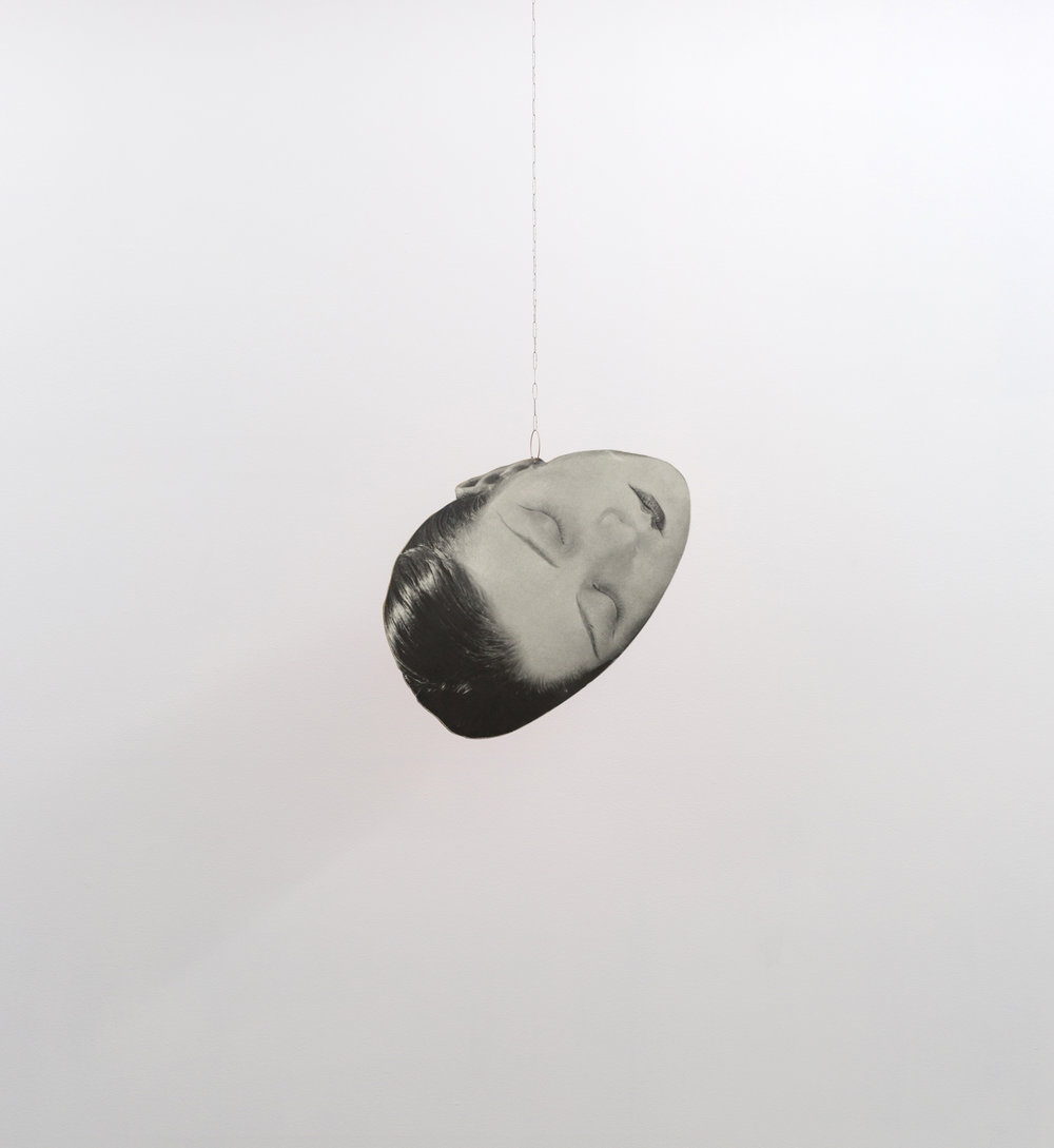 Kiki , 2018 wood, Man Ray poster fragment, paint, earring, sterling silver 39 x 15 in
