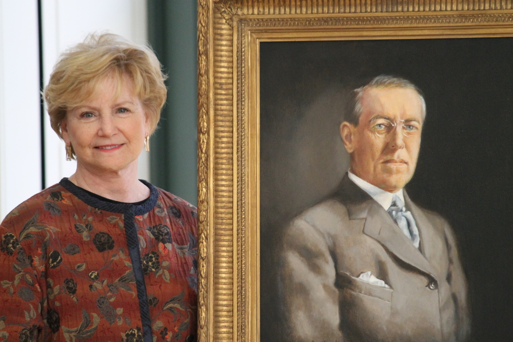 Artist Ann Cowden with the portrait of Woodrow Wilson commissioned by the University of Virginia School of Law.
