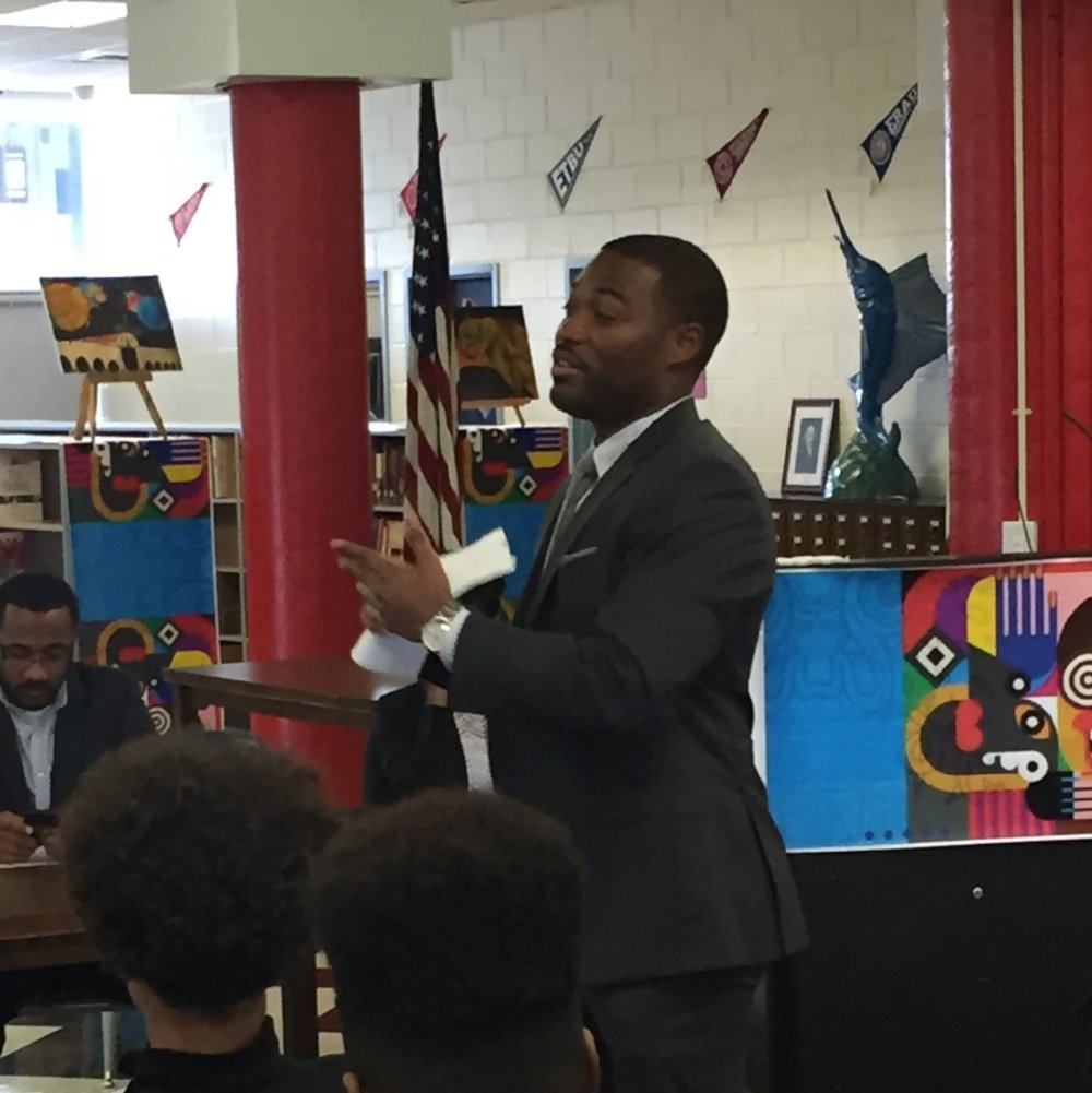 Associate Director, Brandon Wilson, speaking to high school students