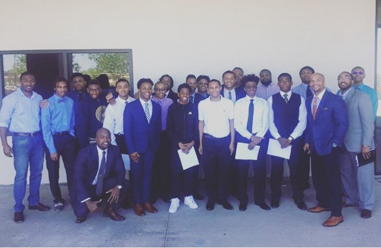Suits for Sons career coaches with a group of high school juniors and seniors from Mufasa's Pride