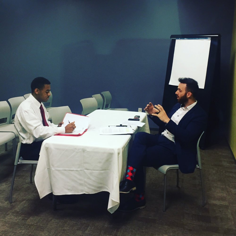 Professional recruiter conducting a mock interview during an Interview Boot Camp