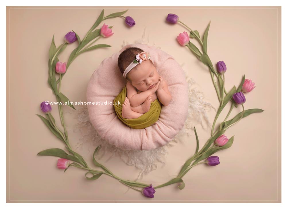 Little baby girl and Tulips