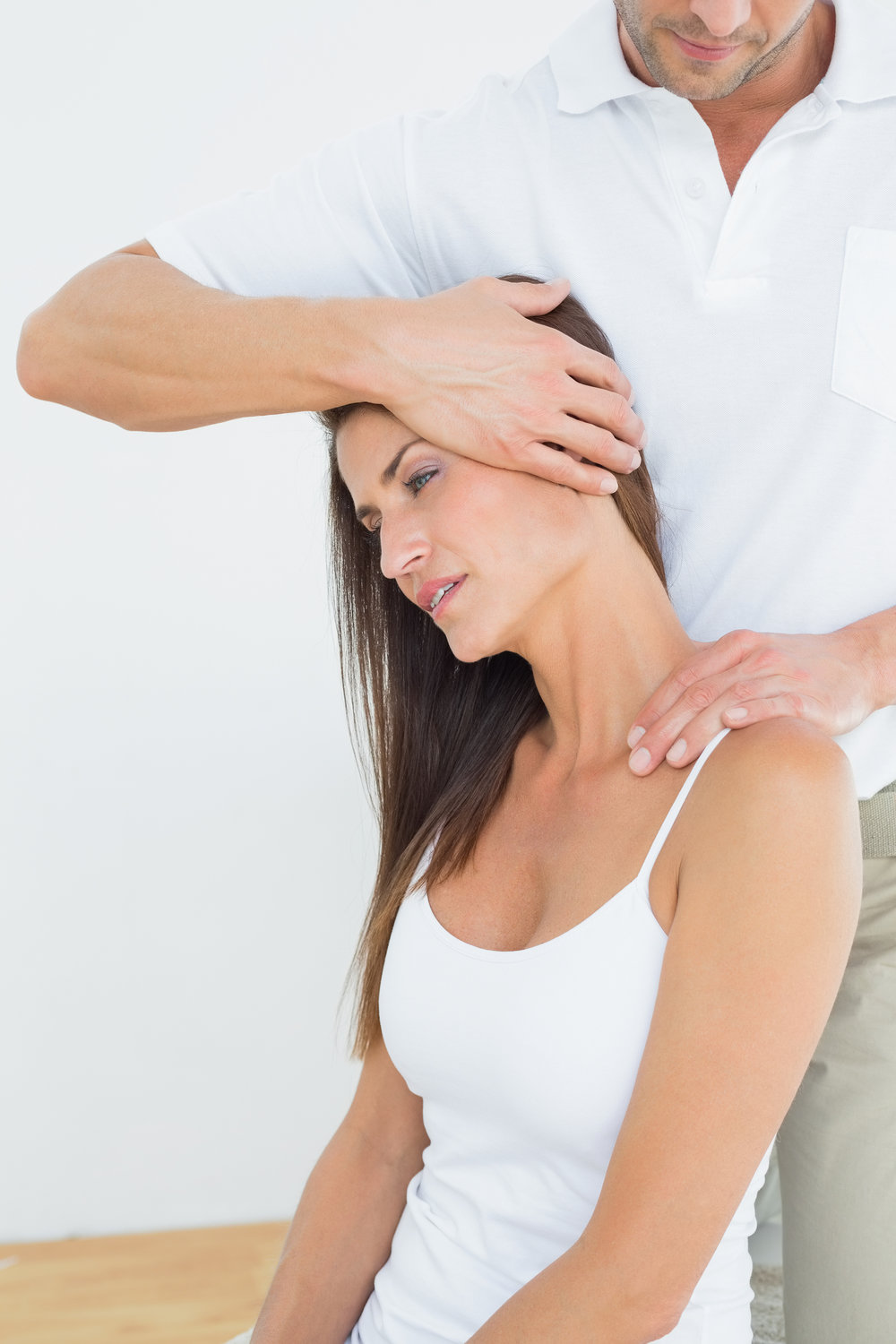 bigstock-Male-chiropractor-doing-neck-a-55674827.jpg