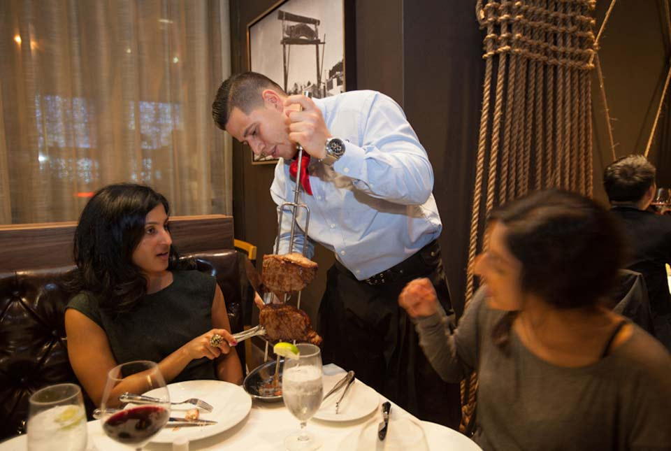 photos_Fogo_De_Chao_serving_meat.jpg