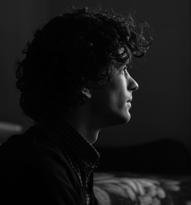 black and white photo of a profile of a man
