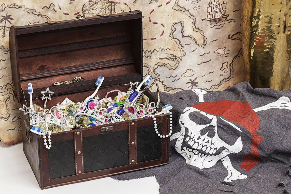 Toothbrushes and toy treasure chest for the kids
