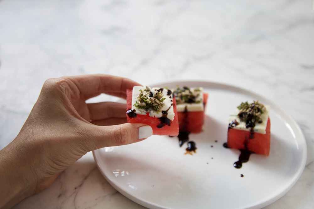 Watermelon bites with gorgonzola, mint gremolata and balsamic reduction