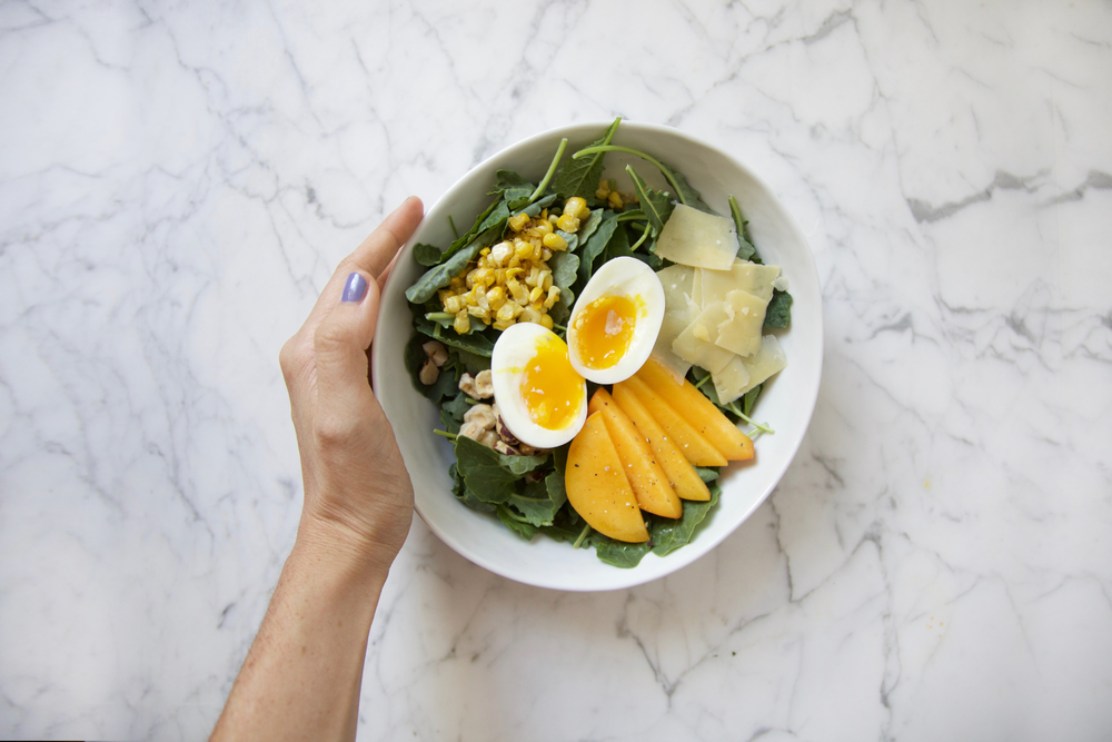 Baby Kale Salad with Peach, Roasted Corn, Parmesan and Soft egg