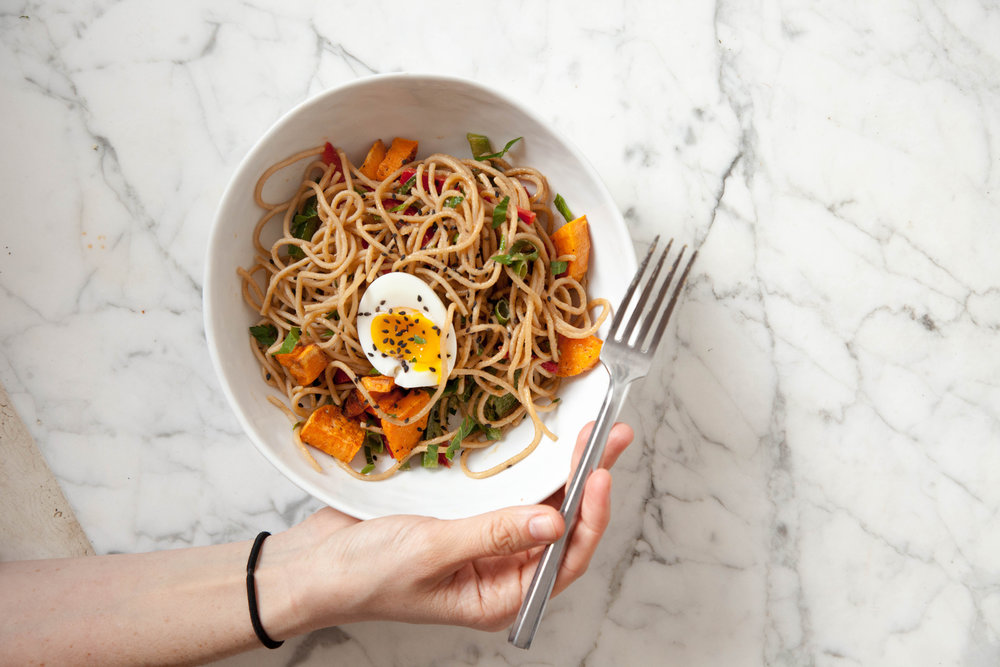 Peanut noodles with sweet potatoes and soft egg