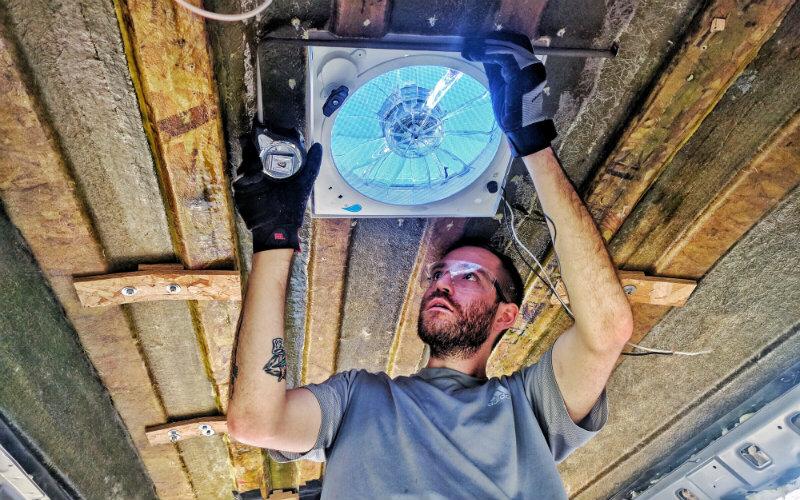 John installing a fan-tastic fan on their high top conversion van.