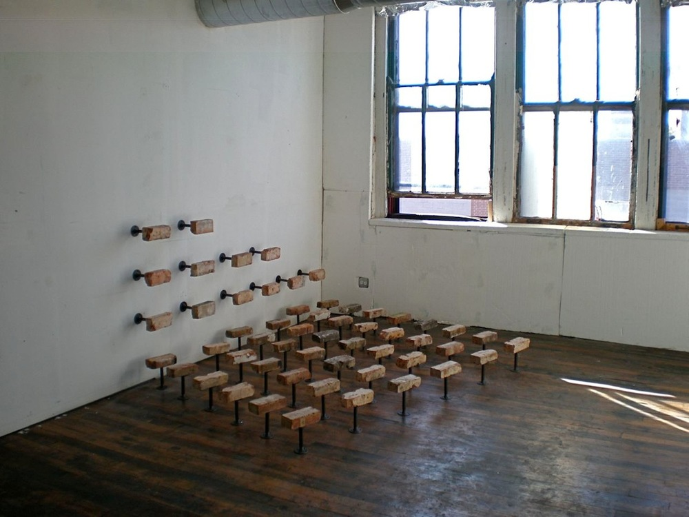Robert Sebanc 54 Common Bricks 2014 96 x 96 x 12 bricks with iron pipe.jpg
