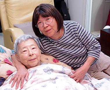 elderly-woman-w-caregiver.jpg