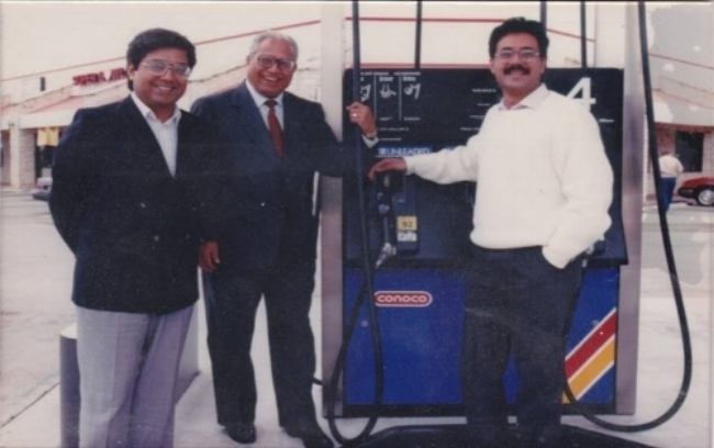 Mr. Noorali Hirani with his sons (Right: Naushad Hirani; Left: Nishat Hirani) opening their first location in Austin, TX