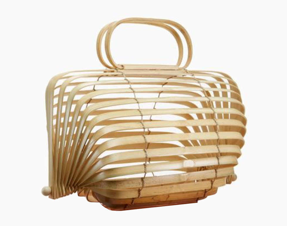 "-  With a focus on creating memorable objects that last a lifetime, Cult Gaia creates ""Objets d'Art"" which embrace the inherent imperfections of natural materials for your wardrobe. The Lilleth Bag is a handmade collapsible bamboo bag that you can fold completely flat to pack and travel with.Buy the Lilleth Bag - £167.08"