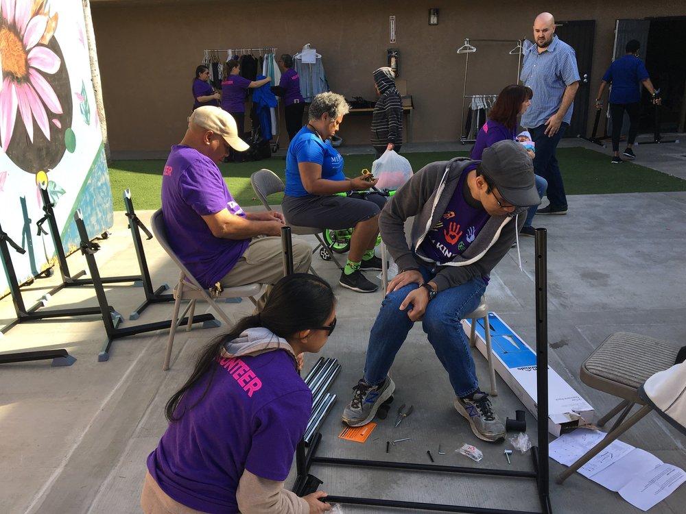 Group assembling bikes and clothing racks.jpg