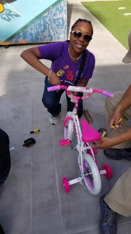 Latrice fixing a bike 2.jpg