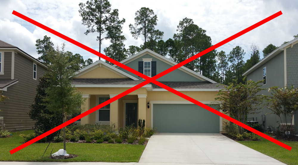 Granted, this house has poor color choices to begin with, but the garage door should never be the second body color!