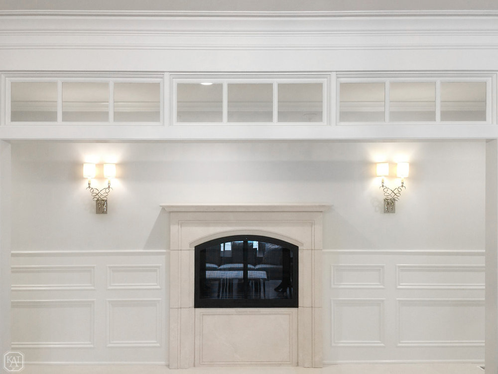 ZITELLA HALLWAY BY FOYER_SCONCES FLANKING FIREPLACE_FROM DINING ROOM_USE THIS ONE.jpg