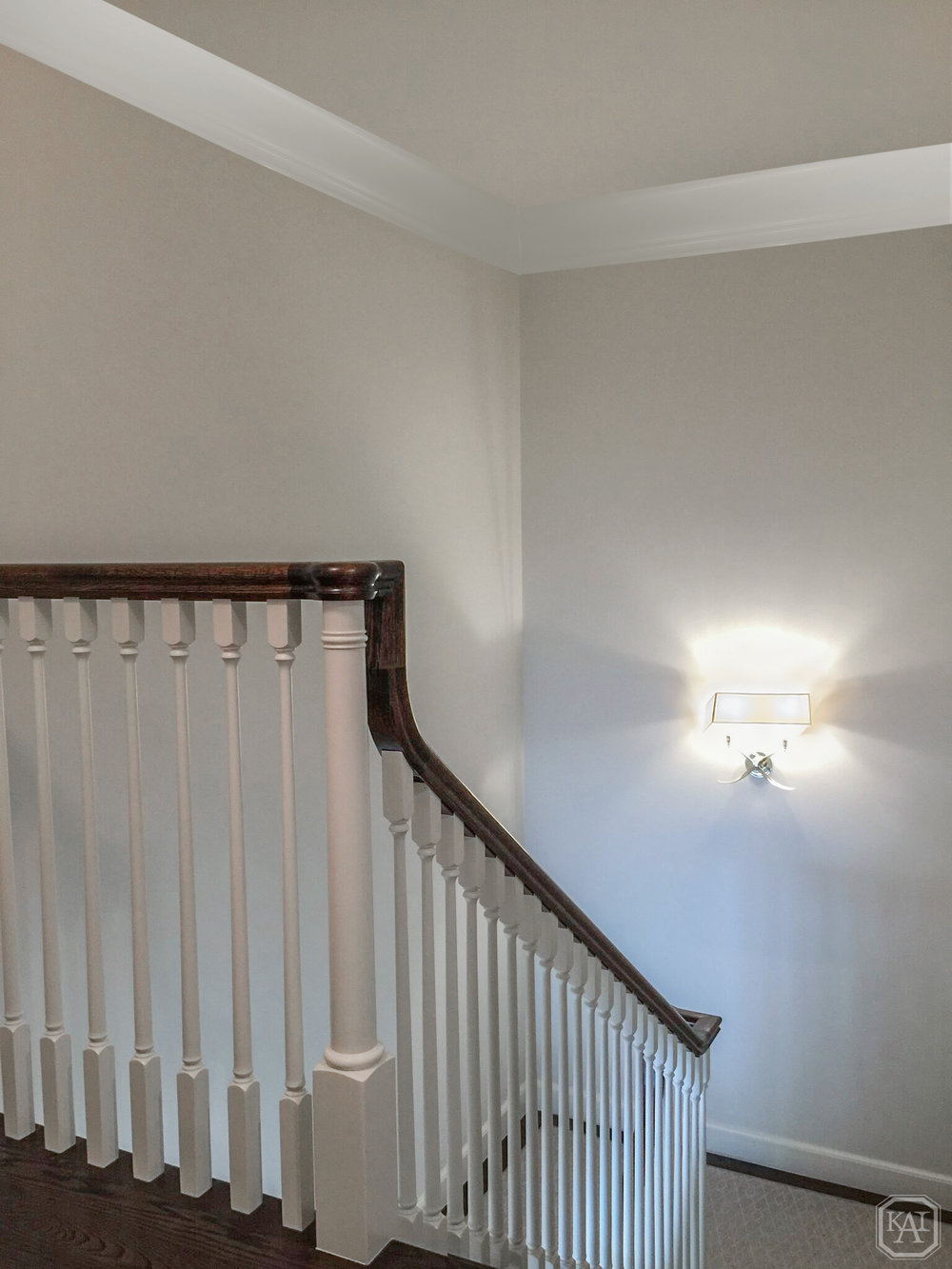 ZITELLA HALLWAY IN BACKSTAIRWAY WITH SCONCE LIGHT ON AND BALLUSTRADE_EDIT 1.jpg