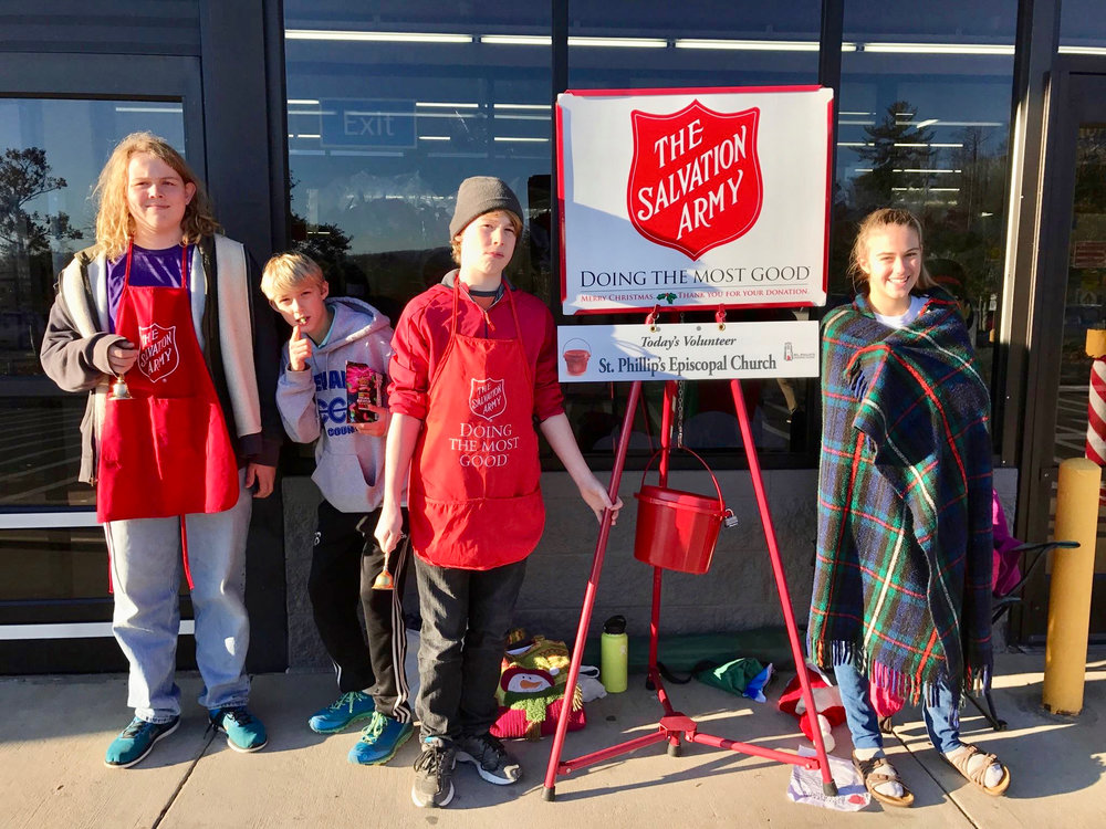 Youth ringing Salvation Army bell