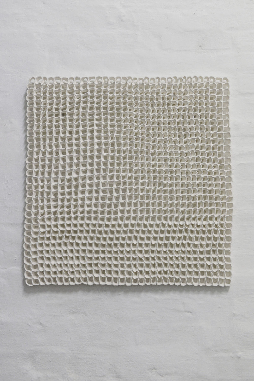 "Stine Jespersen ""Clay Knit"" (Earthenware Mat white, 65x65x2 cm). Photo: Valérie Collart."