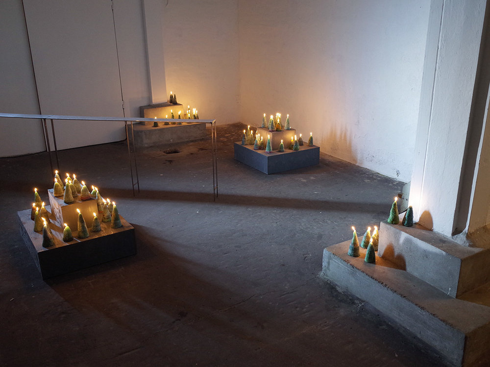 """Isabel Theselius """"Blame it on my wild heart,� 2018 (handmade candle installation (burning miniatyr forest), candle wax, wicks, fire).  Foto: Marko Cesarec."""