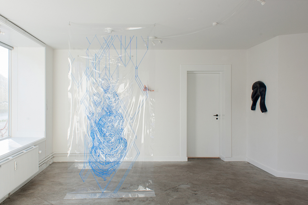 Installation view Blaue Geister Photo: Jacob Friis-Holm Nielsen | Tv: Nina Nowak, Plan A+B, installation of drawings, ink on PVC foil, 2018. Prothese: stardust with diamonds, polyester resin with pigment, 2017. Th: Johanne Skovbo Lasgaard, Esoteric Cherry Stick, Papir, lim, blæk, lak, 2018.