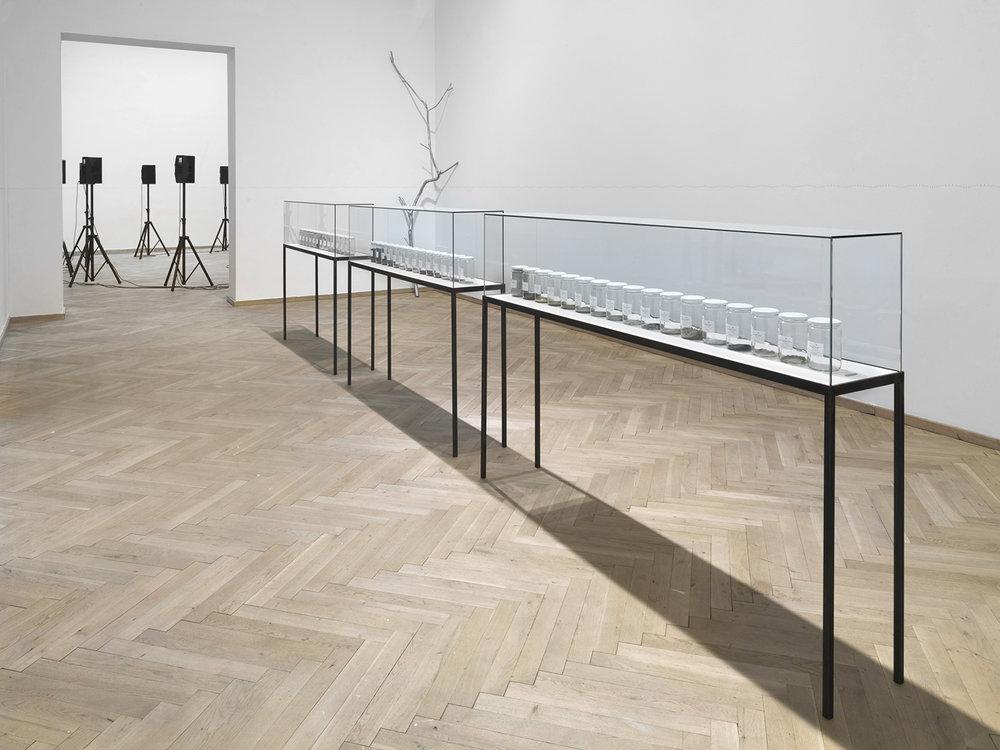 Alicja Kwade, 'Radio (Alicja R-603)' (2014), 'Lampe (Kaiser Idell rot)' (2015), 'Kaminuhr (Zentra)' (2014), 'Parralelwelt (Ast/AntiAst)' (2018), 'NachBild' (2017). Kunsthal Charlottenborg 2018. Foto: Roman März. Courtesy the artist, KÖNIG GALERIE, 303 GALLERY, kamel mennour.