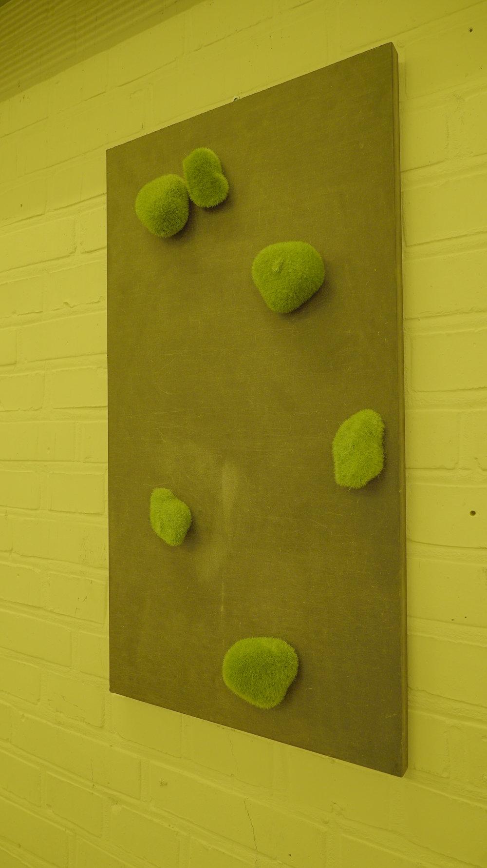 "Theodor Præst Nymark Jensen ""Untitled (fibonacci),"" 2018 black MDF, faux moss stones. Photo: Frej Volander & Theodor Præst Nymark Jensen."