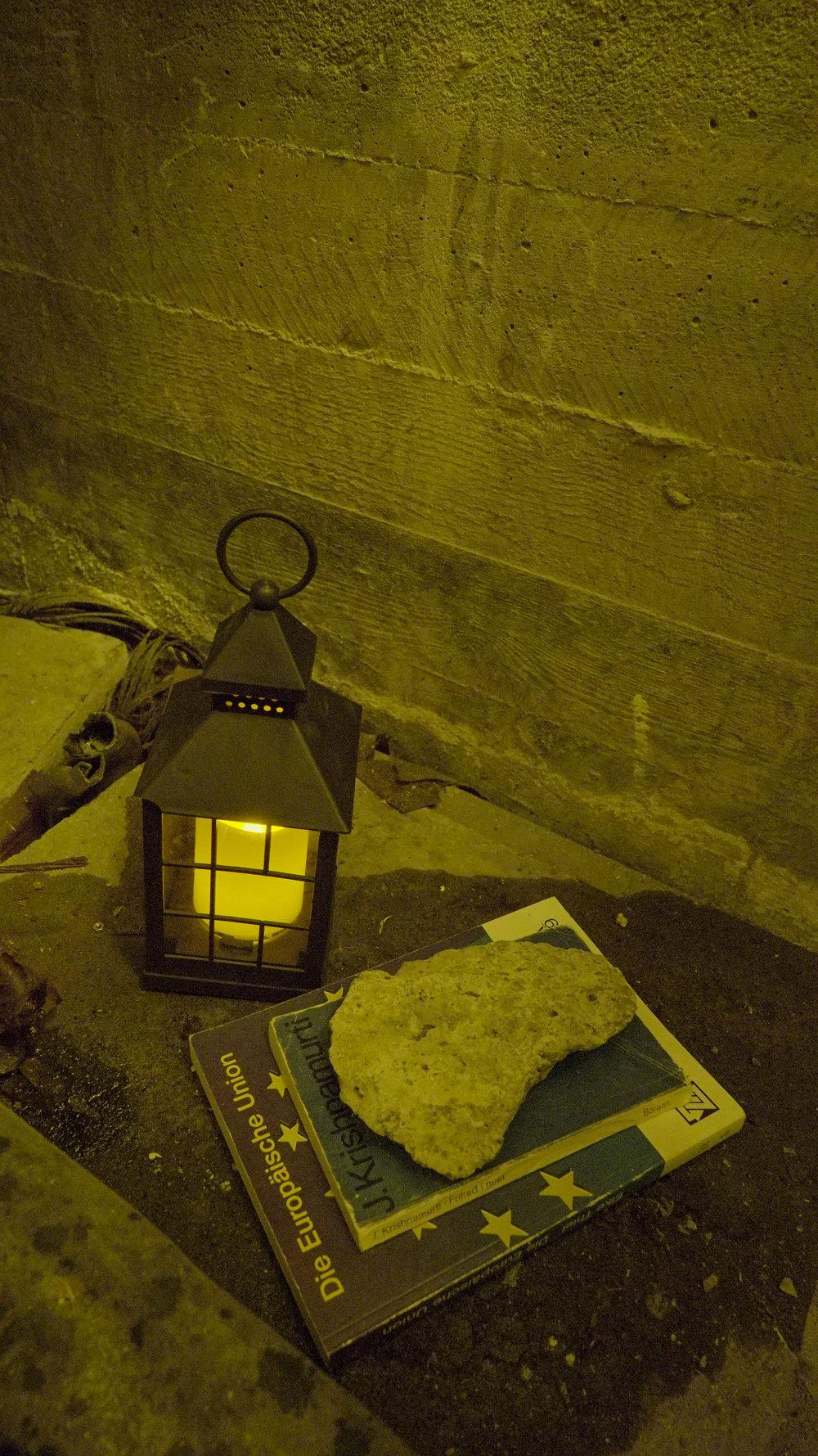 "Theodor Præst Nymark Jensen ""Untitled (Tableau),"" 2018 (faux lantern, books, stone fragment from Armenian church. Photo: Frej Volander & Theodor Præst Nymark Jensen."