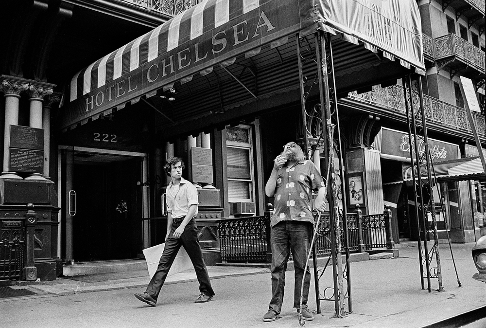 Video artist  Harry Smith  smokes a cigarette in front of the Chelsea Hotel