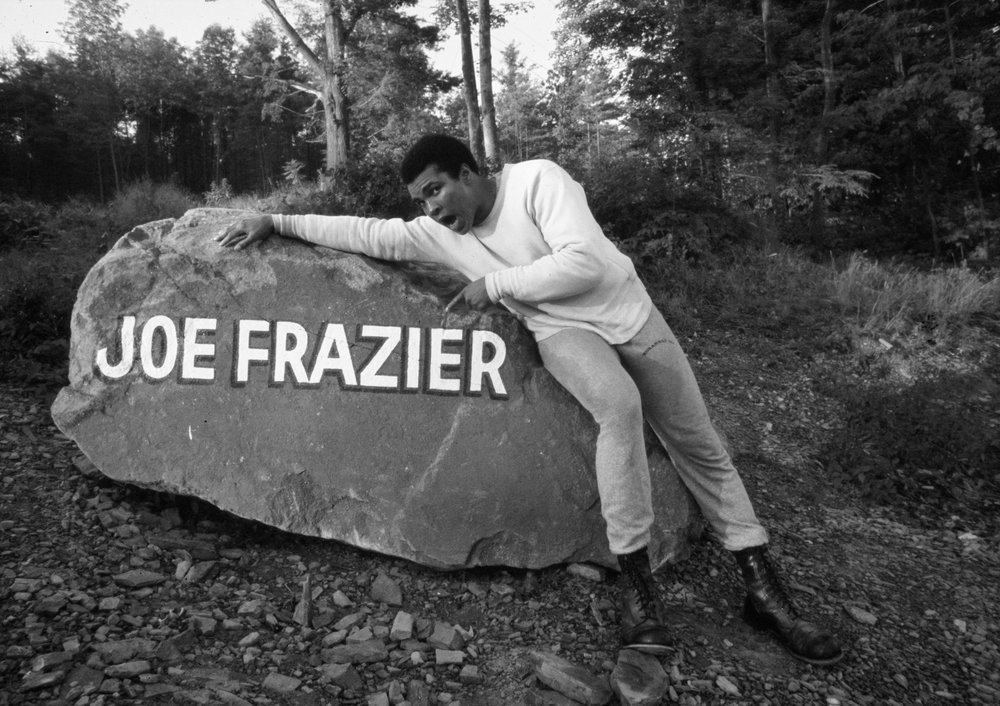Ali Leaning on Joe Frazier Boulder