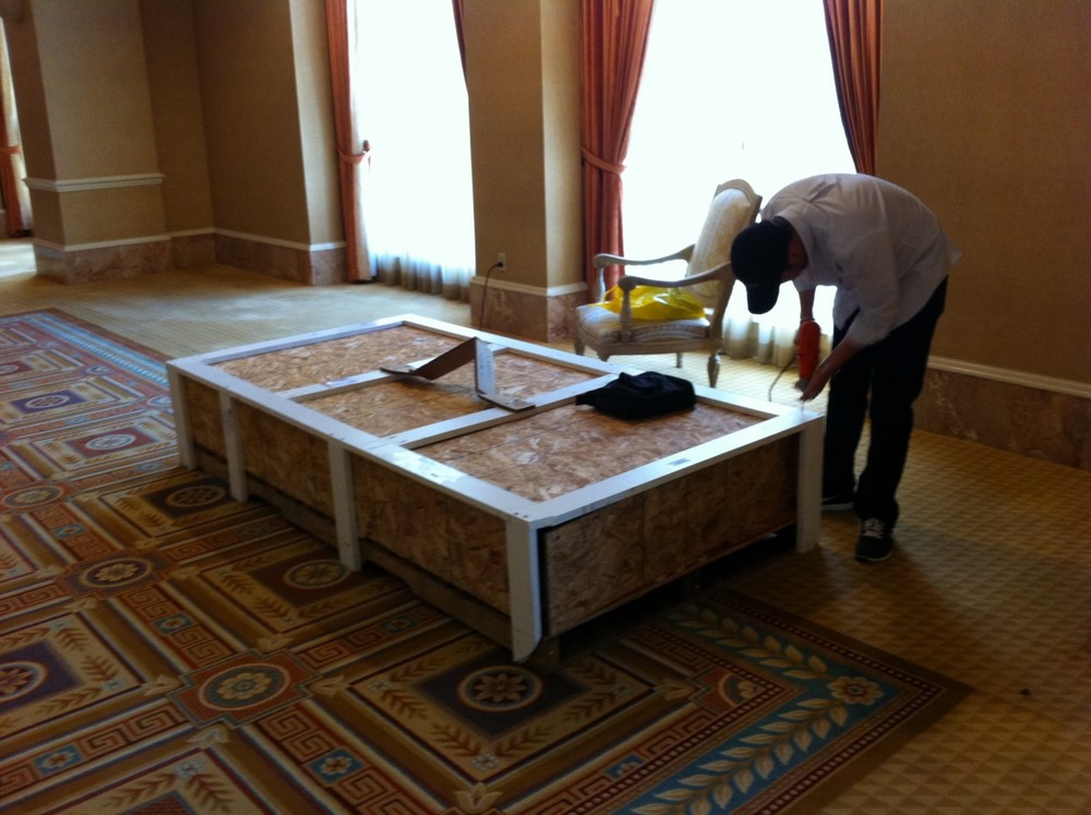 Brandon unpacking a standee for CinemaCon in Las Vegas