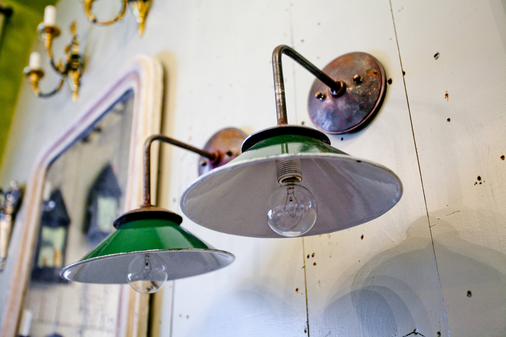 Handmade iron sconces with vintage enamel shades