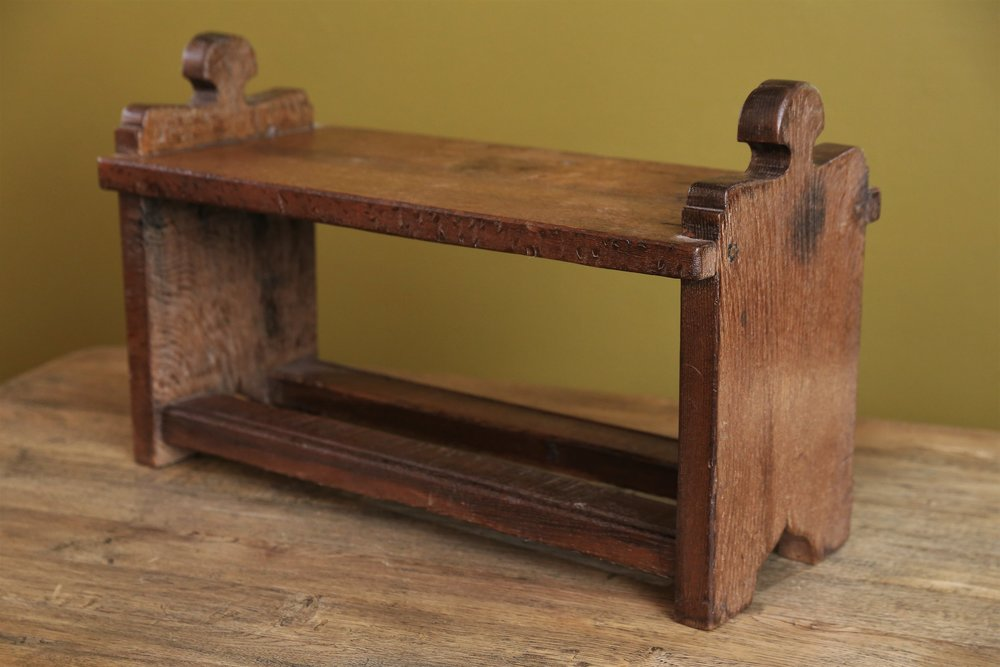 Hand-carved wooden foot stool
