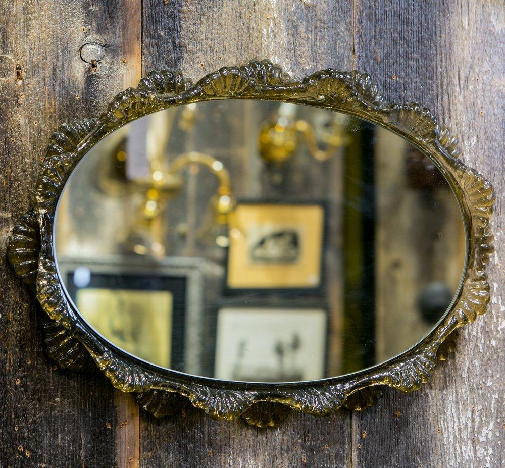 mid-century plastic mirror that mimics Murano glass