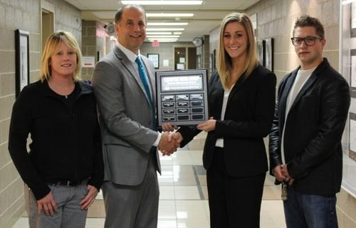 Bonnie Higgins, Randy Acker, Ashley Kiecker and Sachel Josefson, giving Ashley an award)