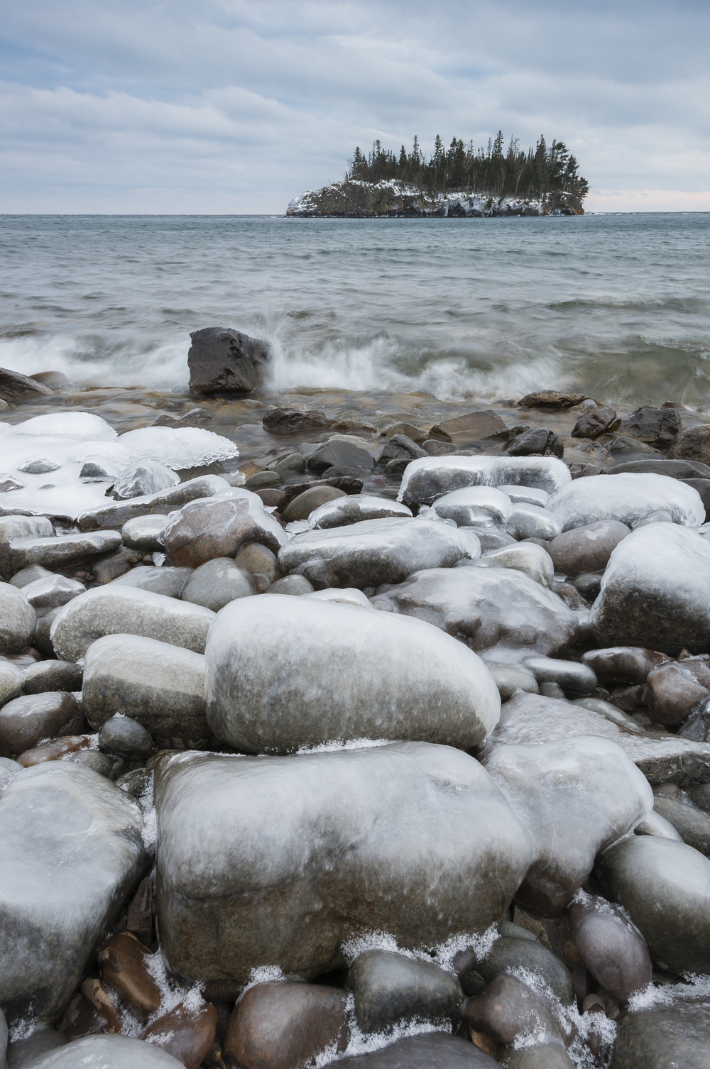 Ice-coated beach rocks and Ellingson Island.