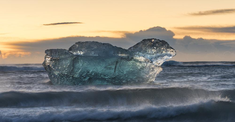 Iceberg floating past Jökulsárlón's Ice Beach