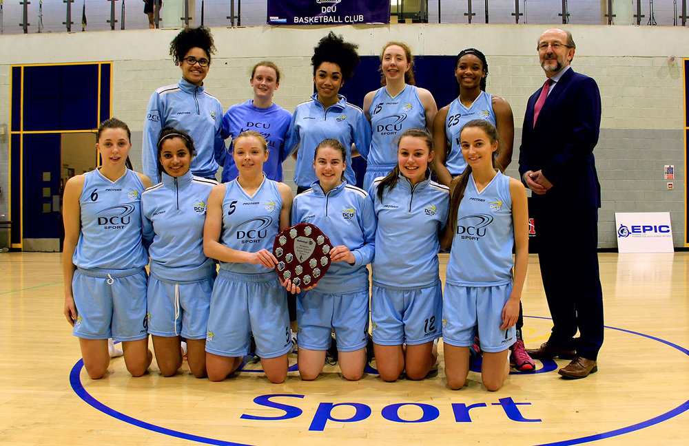 DCU Mercy Superleague Team with Brian McCraith , President of DCU with the 2016 Basketball Ireland Regular Season Winners Trophy