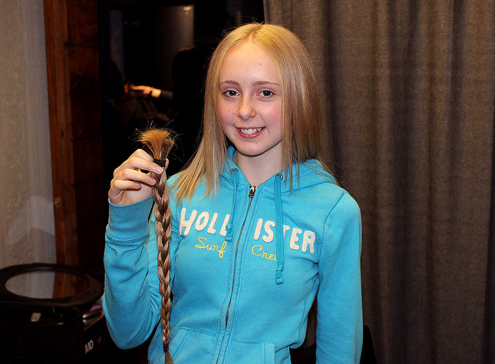 Janet Hodson donates 14 inches of hair to the Rapunzel Ponytails Foundation