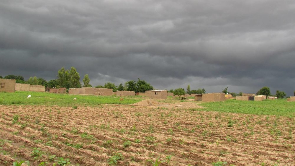 A view of Sebela village under threatening clouds.