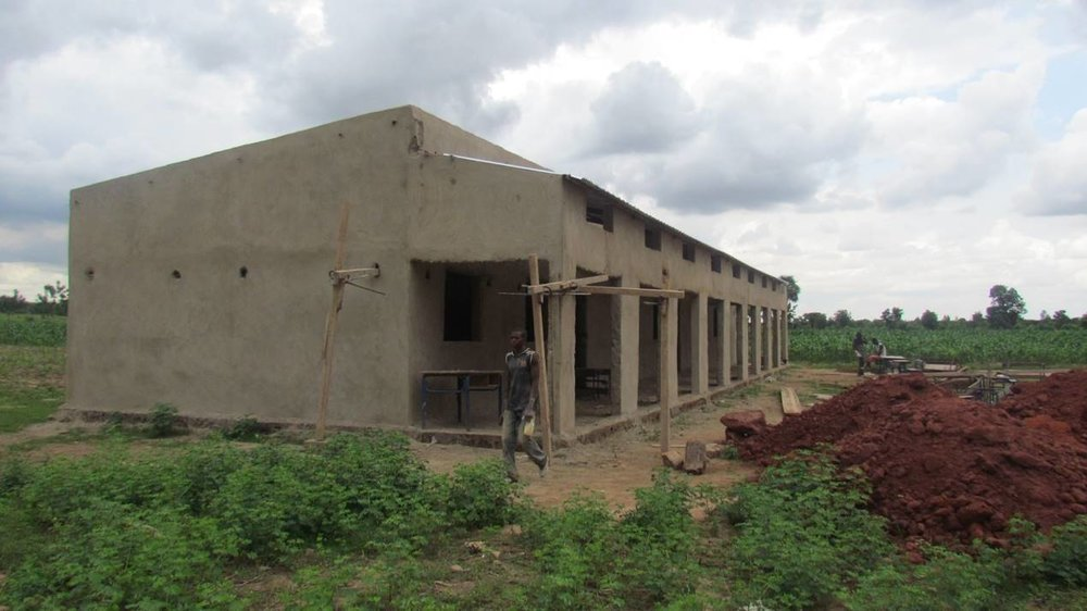 The main school building sports a roof and is plastered. This building includes three classrooms for 7th, 8th, and 9th graders.