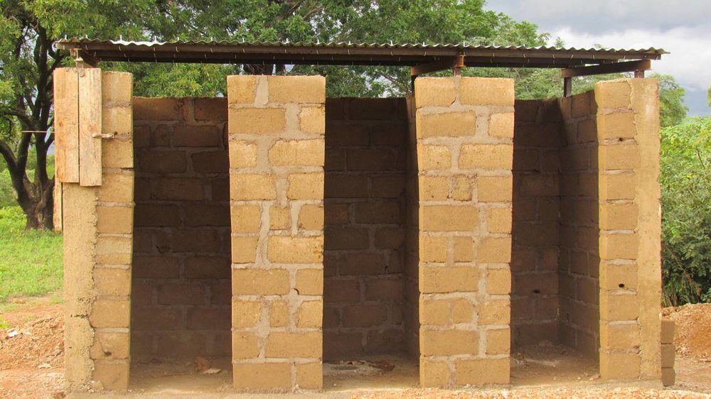 A block of latrines under construction.