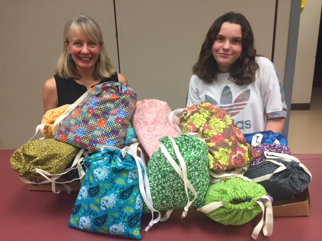 Sklyer & Merritt, our executive director, with the mountain of kits!