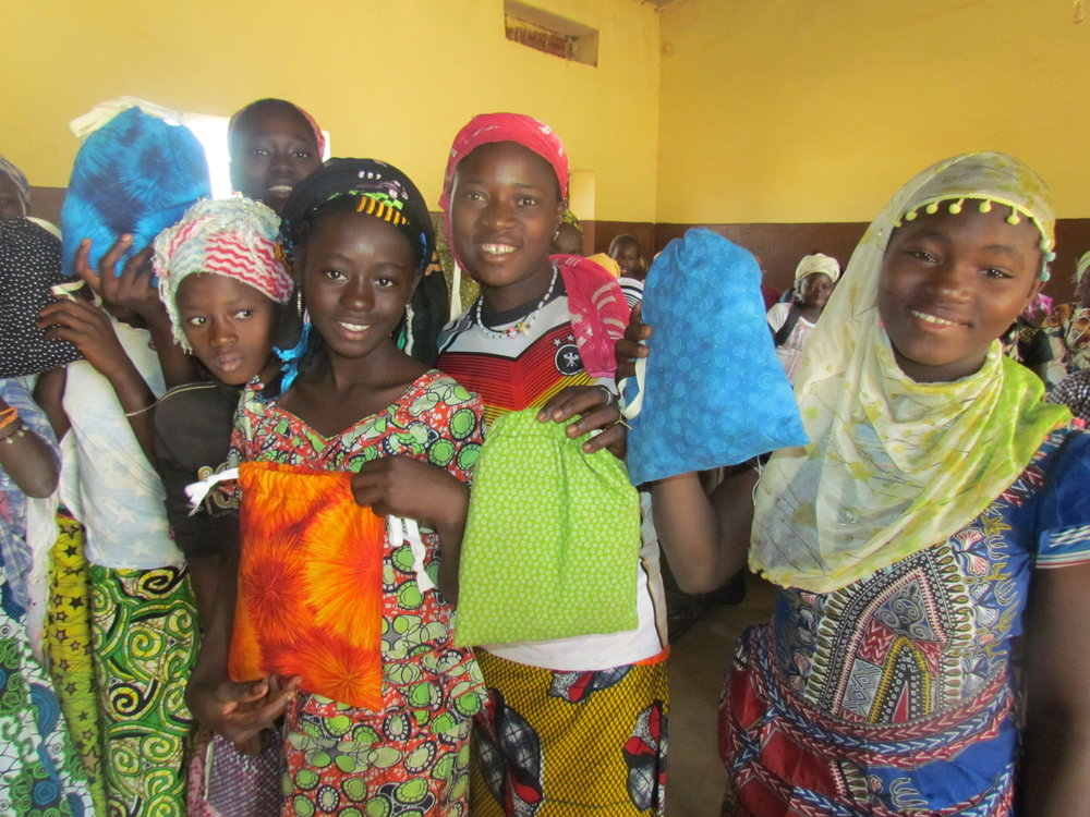 Girls in Simidji celebrate their new menstrual kits.