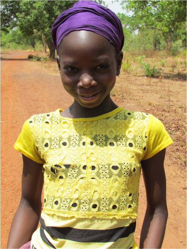 Seventh grader Maimounatou walks 8 miles a day round trip for school, but does it with a smile.